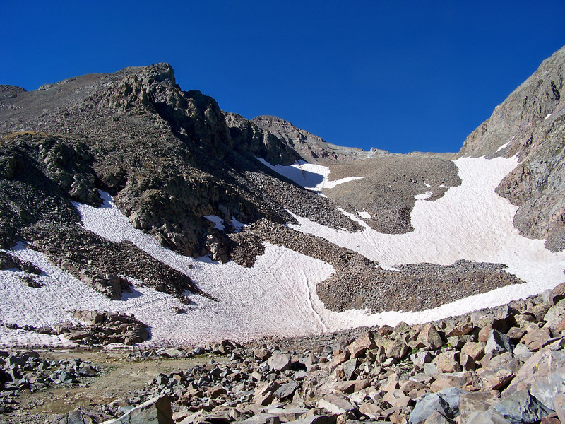 Snow fields in the tumbled rock landscape on the route to the Castle Peak summit (center), Colorado Elk Range
