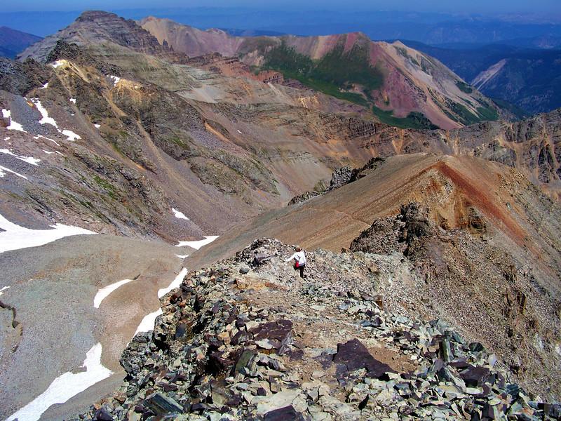 A hiker descends the northeast ridge of Castle Peak, Colorado Elk Range.
