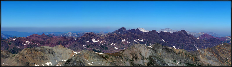 Panoramic view of the Maroon Peaks and colorful Elk Mountains from the Castle Peak summit, Colorado.