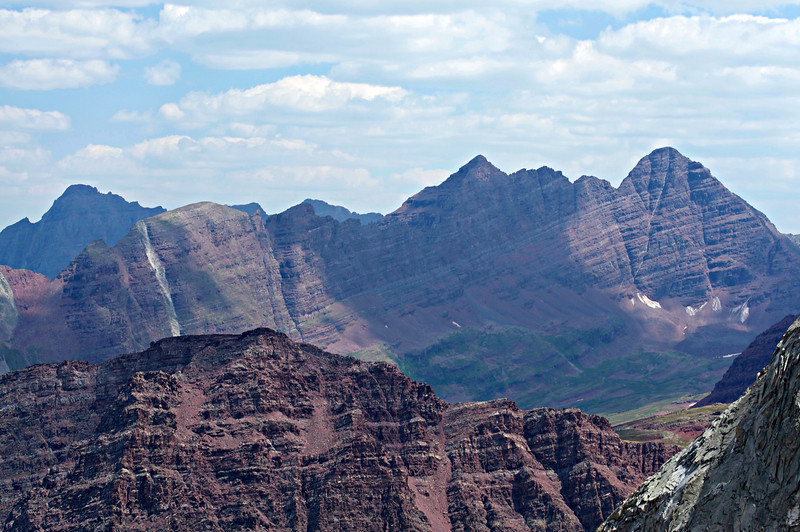 The Maroon Bells west face and Pyramid Peak (left), viewed from the east slopes of Snowmass Mountain; Colorado Elk Range