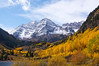 Clouds and fog drift around the Maroon Bells in Autumn, Colorado Elk Range.