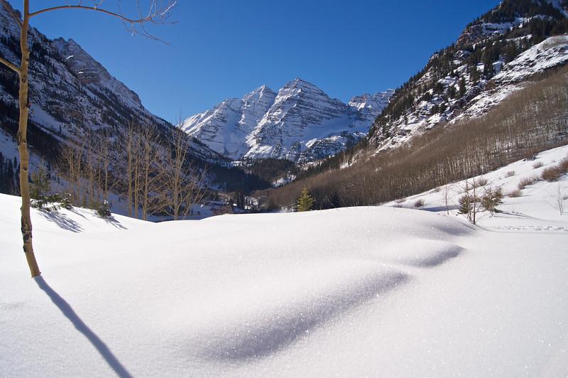 Deep, fresh Christmas snow covers the landscape at Maroon Lake; Colorado Elk Range.