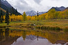 The Maroon Bells autumn pond reflection; Colorado Elk Range.