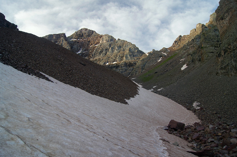 Snow-filled path leading up to the Amphitheater on Pyramid Peak's north approach; Colorado Elk Range.