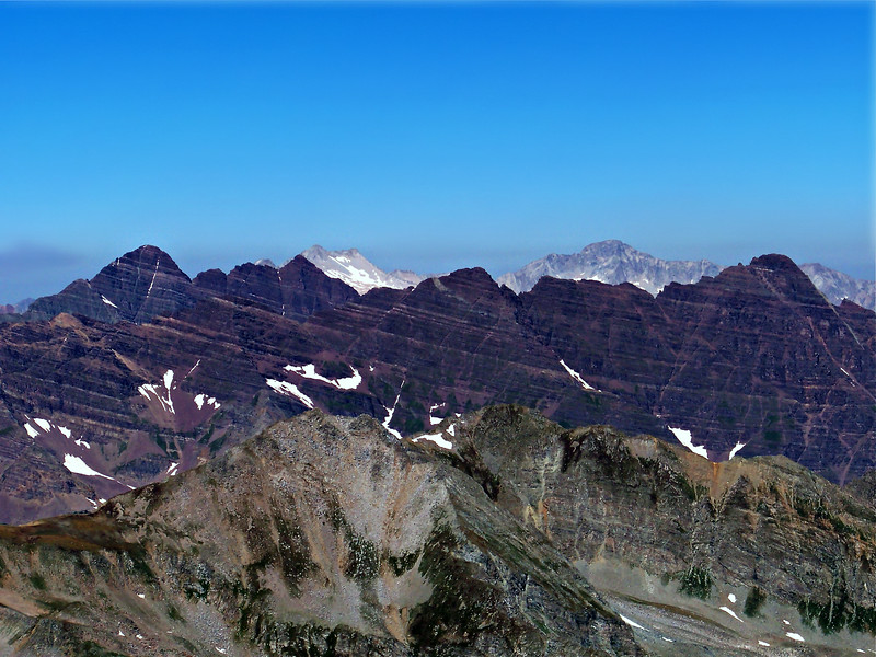 Looking northwest from the Castle Peak summit: Pyramid Peak (far right), Maroon and North Maroon Peaks (far left) and the distant Snowmass Mtn. and Capitol Peak.