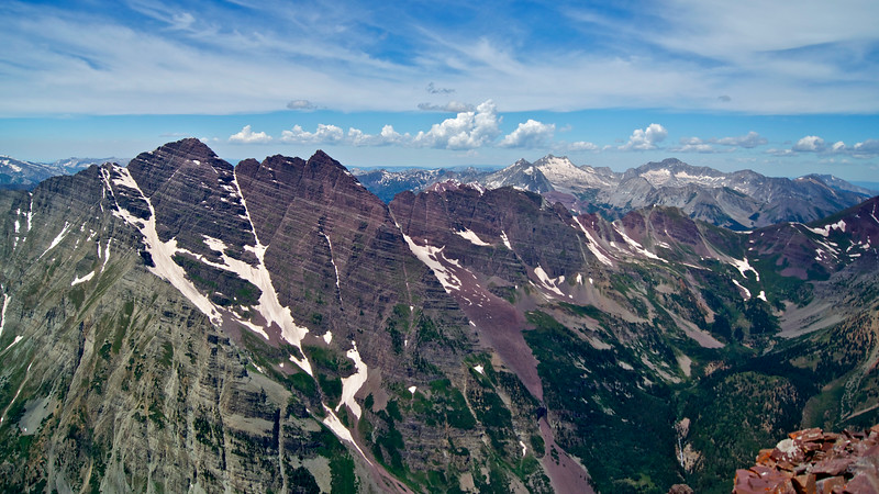 Birdseye view of The Maroon Bells, Snowmass Mountain and Capitol Peak from the summit of Pyramid Peak.; Colorado Elk Range.