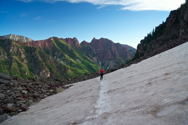 """Hiking into the """"amphitheater"""" along Pyramid Peak's north approach; Colorado Elk Range."""