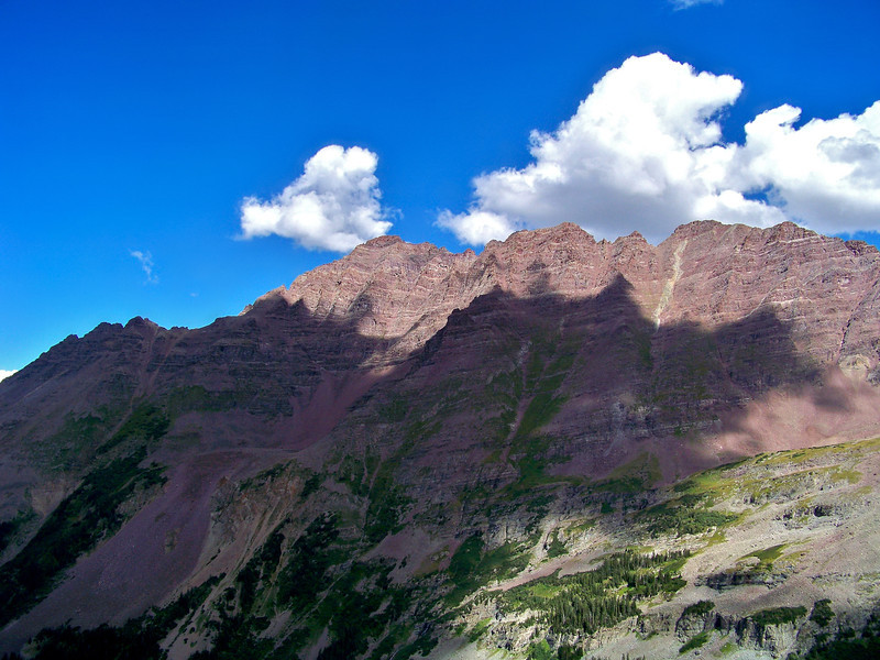Sunlight and shadow across the west face of Pyramid Peak, Colorado Elk Range