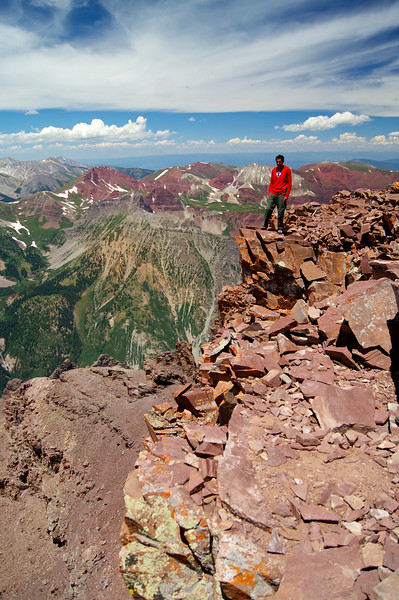 A wobbly-kneed pose on Pyramid's summit perch; Colorado Elk Range.