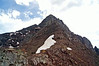 An intimidating look at Pyramid Peak's Northeast Ridge climbing route from the 13,000=foot saddle; Colorado Elk Range.
