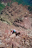 Climbing up a steep pitch 200 vertical feet below Pyramid's summit. Colorado Elk Range.
