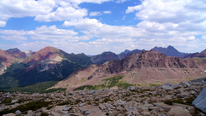 The multicolored landscape of the Elk Mountains, looking east from the east slopes of Snowmass Mountain, Colorado.