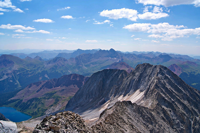 View of the south ridge, Hagerman Peak, Snowmass Lake and the distant Maroon Bells from the summit of Snowmass Mountain, Colorado Elk Range