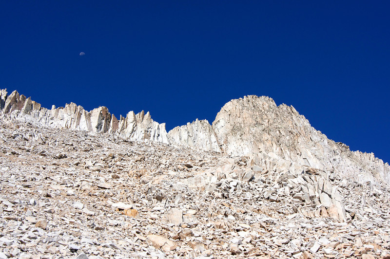 The moon begins to set over the upper south ridge of Snowmass Mountain, Colorado Elk Range