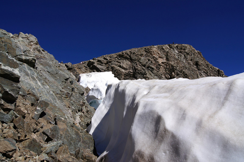 A crevasse between rock and snow near the Torreys summit, Colorado Front Range.