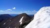 Grays Peak viewed from the edge of a snowfield on Torreys' summit, Colorado Front Range.