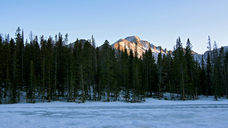 Longs Peak's northwest face as seen from the frozen surface of Nymph Lake; Rocky Mountain National Park, Colorado.
