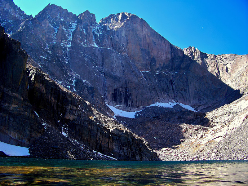 """Longs Peak """"Diamond Face"""" towers over the clear water of Chasm Lake; Rocky Mountain National Park"""