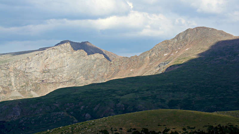"Late afternoon sun and shadows highlight the famous ""sawtooth"" ridge between the summits of Mt. Evans and Mt. Bierstadt; Colorado Front Range."