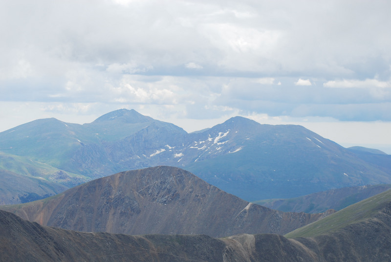 From Shoulder looking ESE with Mt. Evans elev. 14,264 ft. (left) and Mt. Bierstadt elev. 14,050 ft. (right)<br /> <br /> Argentine Pass is the Jeep trail climbing the saddle in the foreground.