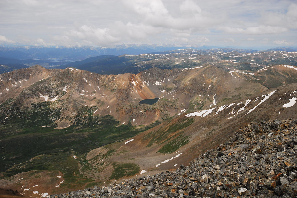 Looking West from Grays Peak at Chihuahua Gulch. Grizzly Peak elev. 13,427' is up and to the right of the Alpine Lake. Arapahoe Basin ski area is on the backside of the mountain in this foto.