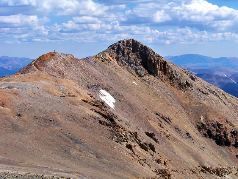 Hikers along the southwest ridge approach the summit of Mt. Lincoln; viewed from the summit of Mt. Bross; Colorado Mosquito Range.