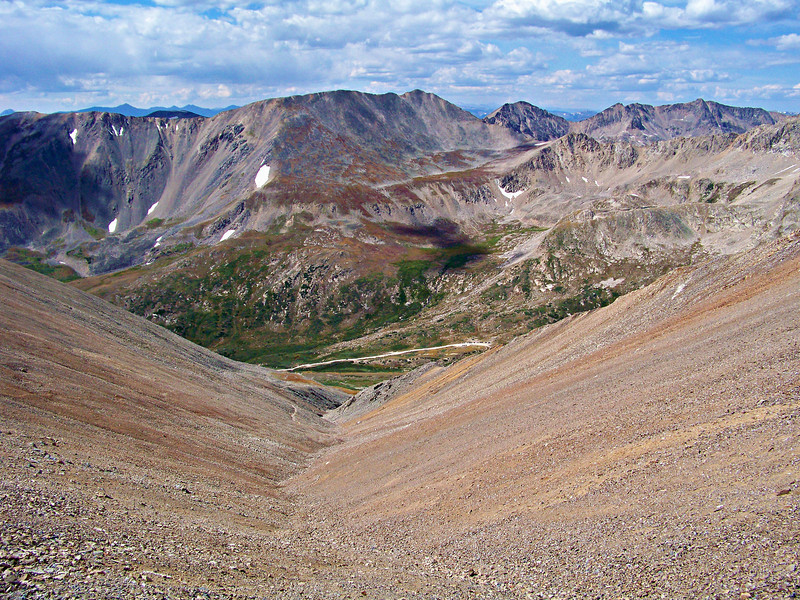 Looking down a gentle, 2000 foot, scree slope on the west face of Mt. Bross.