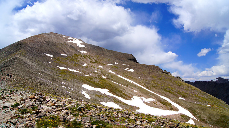 Storm clouds gather over the broad northeast face and gentle east ridge of Quandary Peak; Colorado Tenmile Range.