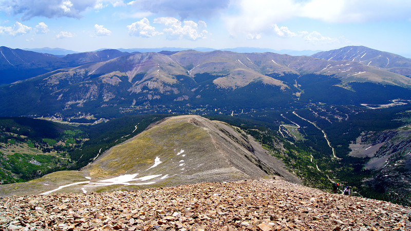 Hoosier Pass road winds through the high forest beyond the east ridge of Quandary Peak (viewed from Quandary's summit); Colorado Tenmile Range.