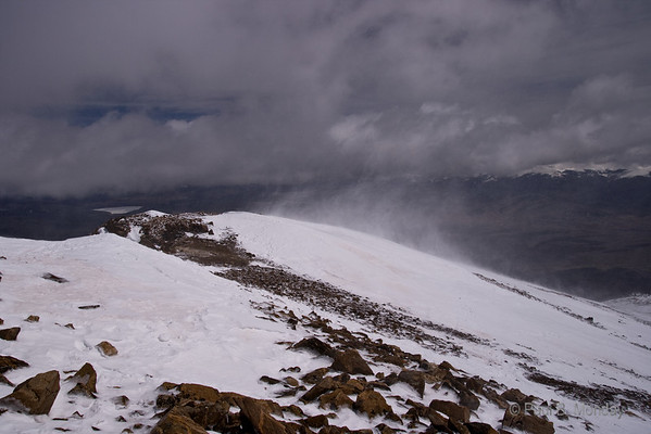 Looking down the ridge, trying to capture just how blustery the day was at 14,400 feet or so.