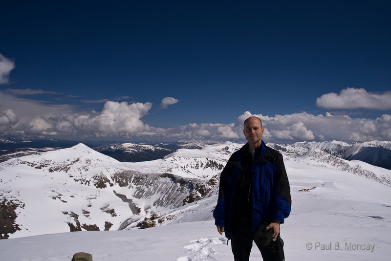 Yes, I never post pictures of myself in public .... but what the hell.  It was crazy warm at the summit but the storms were rolling in.  I put SPF 55 on my head as soon as I took my hat off :-)  This ascent was NOTHING like Mt. Elbert a few weeks back ... this was warm and slushy at the top, Elbert was blustery and cold.  What a difference 500 feet and 3 weeks makes!