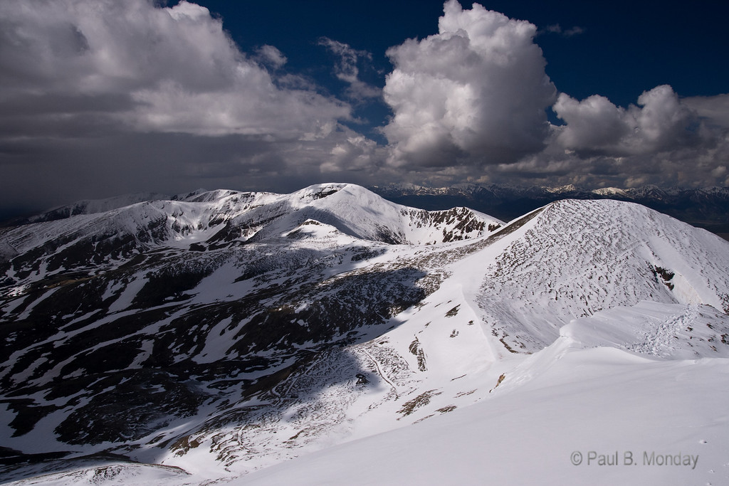 Looking back over the ascent and across the saddle to a neighboring 14er.