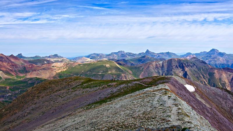 Hikers approach the summit of Handies Peak via the north ridge; Colorado San Juan Range.