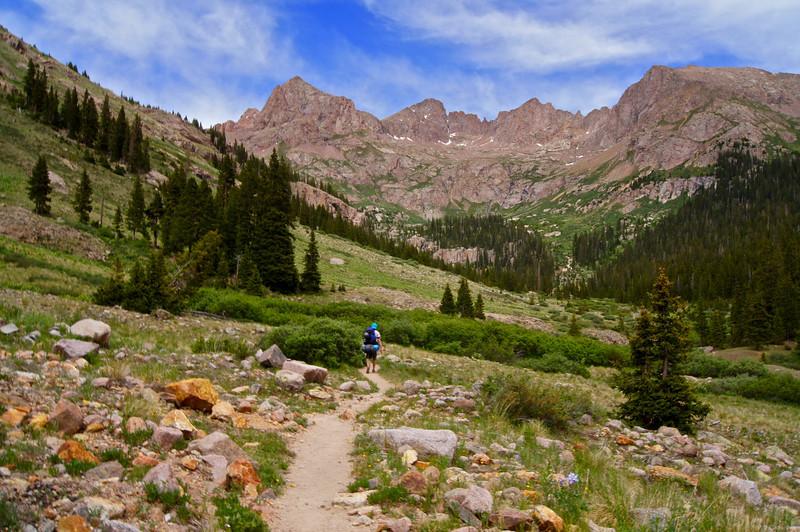 Backpacking into the Chicago Basin.  14er Windom Peak appears straight ahead; Colorado San Juan Range.