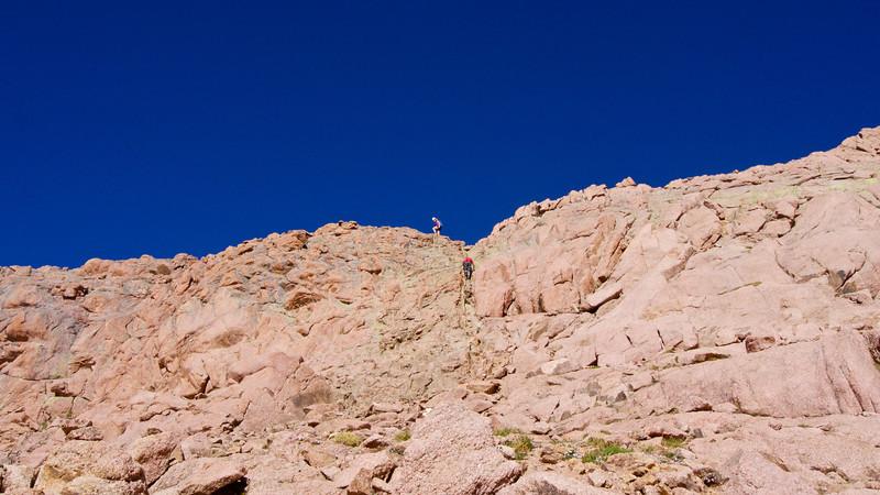"Hikers carefully ascend the ""green gulley"" just below the northeast ridge of Mount Eolus; Colorado San Juan Range"