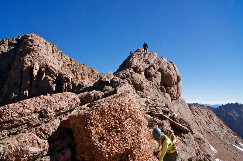 Over the hump and across the Catwalk (13,850 ft.) along the northeast ridge of Mount Eolus; Colorado San Juan Range