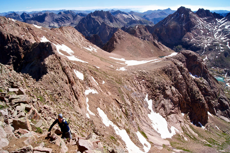 Climbing the East Face of Mount Eolus; the Catwalk is visible directly behind the hiker; Colorado San Juan Range