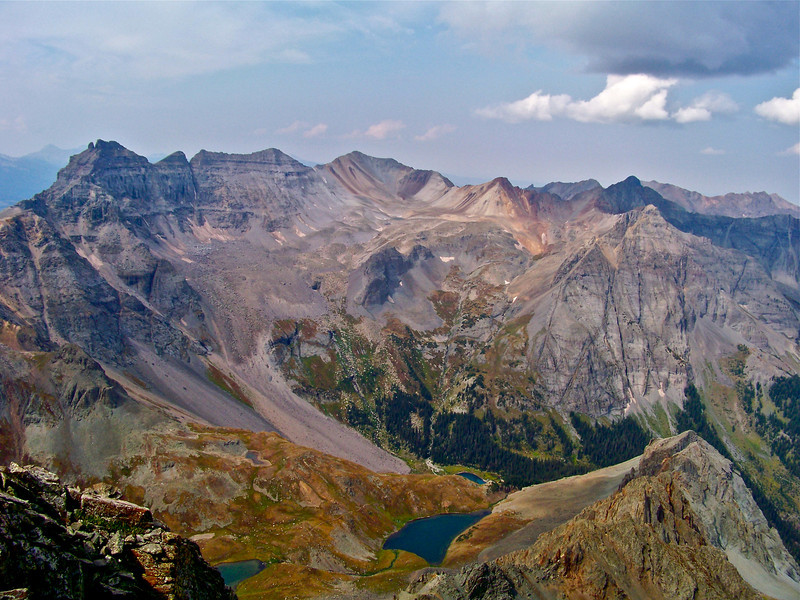 Dallas Peak (far left; 13,809 ft.) as seen from the summit of Mt. Sneffels;  Blue Lakes 3000 ft. below.  Colorado San Juan Mountains.