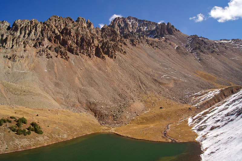 """The west face of Mount Sneffels towers over the """"middle"""" Blue Lake; Colorado San Juan Mountains."""