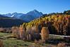 Mount Sneffels forms a stark backdrop to this serene meadow along Dallas Creek Road; Colorado San Juan Mountains.