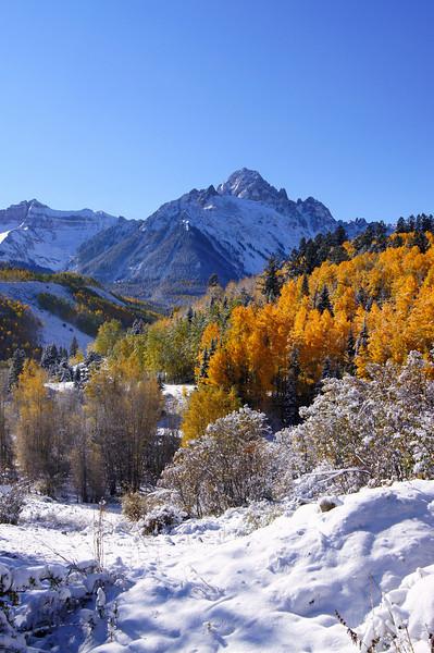 Autumn's first snow along Dallas Creek beneath Mount Sneffels, Colorado San Juan Range.