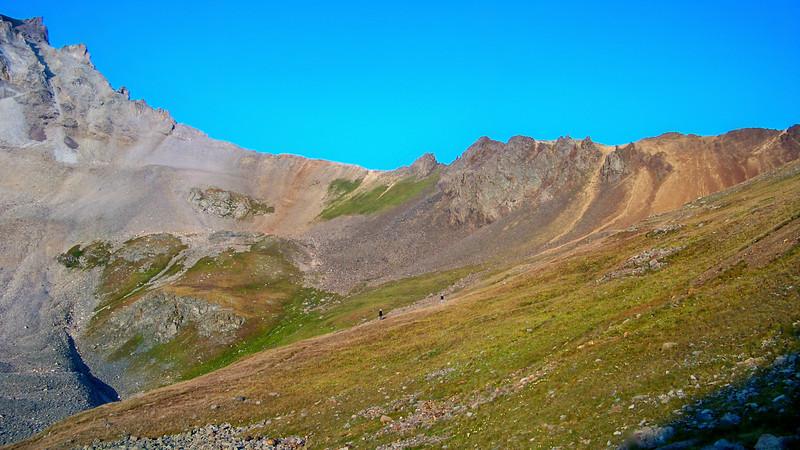 Hikers in the upper southeast basin of Mt. Sneffels, Colorado San Juan Mountains