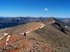 Hikers begin the traverse between Redcloud and Sunshine Peaks, Colorado San Juan Range.
