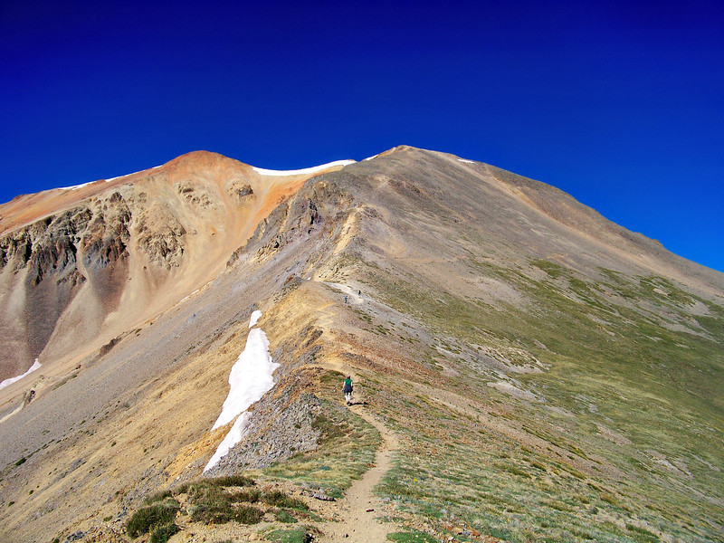 Hikers make their way up Redcloud's northeast ridge; Colorado San Juan Range.