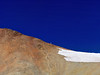 A lone hiker ascends the Redcloud north ridge, Colorado San Juan Range.
