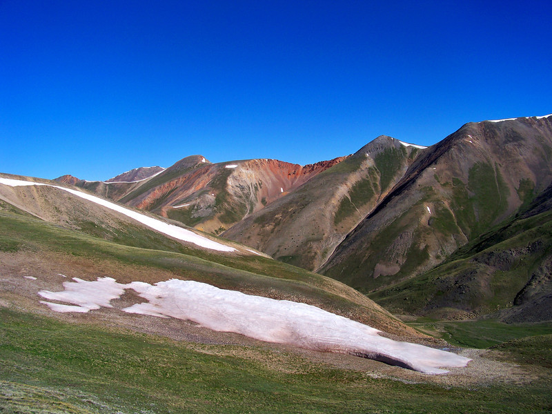 The gently rolling hills of the Silver Creek valley beneath Redcloud's northwest slopes; Colorado San Juan Range.