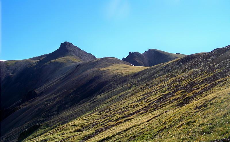 Lush, grassy slopes and gentle peaks encircle the Silver Creek valley beneath Redcloud Peak; Colorado San Juan Range.