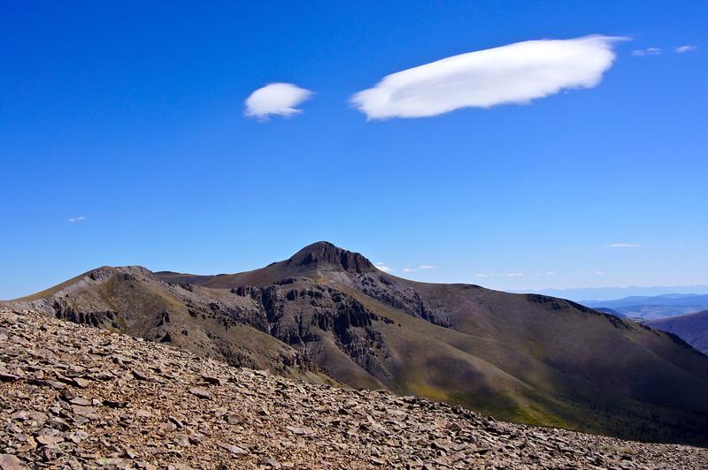 Stray altostratus clouds over Organ Mountain, viewed from San Luis Peak; Colorado San Juan Range
