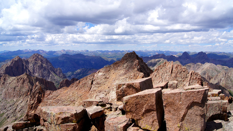 The rugged ridge line of Sunlight Peak, viewed from Windom's summit block; Arrow and Vestal, distant right; Colorado San Juans.