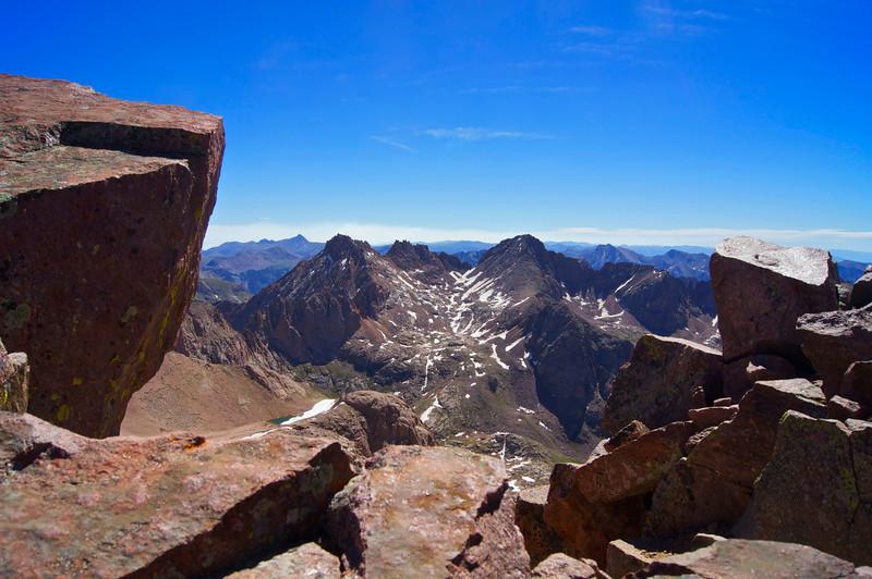 Summit slabs on Mount Eolus frame Sunlight and Windom Peaks to the east; Colorado San Juan Range